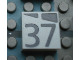 Part No: Mx1022Apb193  Name: Modulex, Tile 2 x 2 with Dark Gray Slopes and Calendar Week Number '37' Pattern