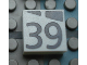 Part No: Mx1022Apb195  Name: Modulex, Tile 2 x 2 with Dark Gray Slopes and Calendar Week Number '39' Pattern