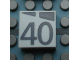 Part No: Mx1022Apb196  Name: Modulex, Tile 2 x 2 with Dark Gray Slopes and Calendar Week Number '40' Pattern