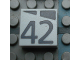 Part No: Mx1022Apb198  Name: Modulex Tile 2 x 2 with Dark Gray Slopes and Calendar Week Number '42' Pattern