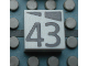 Part No: Mx1022Apb199  Name: Modulex, Tile 2 x 2 with Dark Gray Slopes and Calendar Week Number '43' Pattern