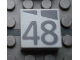 Part No: Mx1022Apb204  Name: Modulex Tile 2 x 2 with Dark Gray Slopes and Calendar Week Number '48' Pattern