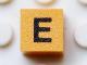 Part No: Mx1011Apb123  Name: Modulex, Tile 1 x 1 with Black 'E' Pattern (Thin Font)
