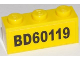 Part No: 3622pb065  Name: Brick 1 x 3 with Black 'BD60119' on Yellow Background Pattern (Sticker) - Set 60119