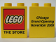Part No: 4066pb001  Name: Duplo, Brick 1 x 2 x 2 with The Lego Store Chicago 2000 Opening Pattern