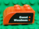 Part No: 6215pb02R  Name: Brick, Modified 2 x 3 with Curved Top with 'Guest' and 'Woodman' on Black and Red Background Pattern Model Right Side (Sticker) - Set 8655