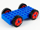 Part No: 30076c02  Name: Brick, Modified 4 x 10 with 4 Pins with 4 Red Wheel FreeStyle with Technic Pin Hole and 4 Black Tire 24mm D. x 8mm Offset Tread - Interior Ridges (30076 / 6248 / 3483)