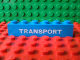 Part No: 3009pb077  Name: Brick 1 x 6 with White 'TRANSPORT' Thick Pattern (in some versions of Set 113)