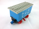 Part No: 3443c06pb01  Name: Train Battery Box Car with Two Contact Holes, Red Switch Lever, Blue and Red Magnets, Red Wheels, and Light Gray Roof with Hinged Doors Pattern on Both Sides (Stickers) - Set 7720