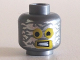 Part No: 3626cpb1113  Name: Minifigure, Head Alien with Robot Yellow Eyes and Mouth and Aluminum Foil Blotches Pattern - Hollow Stud