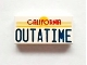 Part No: 3069bpb0288  Name: Tile 1 x 2 with Groove with Red 'CALIFORNIA' and Blue 'OUTATIME' Pattern
