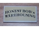 Part No: 87079pb0026  Name: Tile 2 x 4 with 'HONEST BOB's WAREHOUSING' on Tan Background Pattern (Sticker) - Set 8199