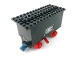 Part No: 3443c05pb01  Name: Train Battery Box Car with Two Contact Holes, Red Switch Lever, Blue and Red Magnets, Red Wheels, and Black Roof with '182' Pattern on Both Sides (Stickers) - Set 182