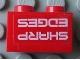 Part No: 3004pb084  Name: Brick 1 x 2 with 'SHARP EDGES' Upside Down Pattern (Sticker) - Set 7701