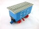Part No: 3443c03pb01  Name: Train Battery Box Car with Three Contact Holes, Red Switch Lever, Blue and Red Magnets, Red Wheels, and Light Gray Roof with Hinged Doors Pattern on Both Sides (Stickers) - Set 7720