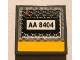 Part No: 3068bpb0365  Name: Tile 2 x 2 with Groove with Black 'AA 8404' on Grille and Yellow Line Pattern (Sticker) - Set 8404