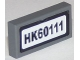 Part No: 3069bpb0433  Name: Tile 1 x 2 with Groove with Black 'HK60111' Pattern (Sticker) - Set 60111