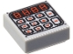 Part No: 3070bpb089  Name: Tile 1 x 1 with Groove with Black and Red Digital Keypad Pattern