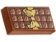 Part No: 3069bpb0440  Name: Tile 1 x 2 with Groove with Candy Bar Chocolate Blocks and Gold Bow Pattern